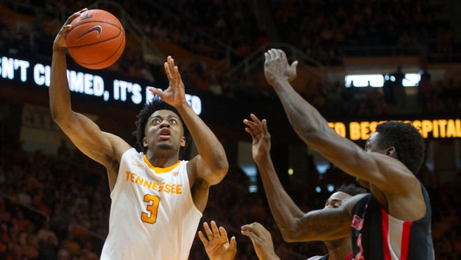 Tennessee's Robert Hubbs III (3) takes a shot while defended by Georgia players during a game between Georgia and Tennessee in Thompson-Boling arena Thursday, Feb. 9, 2017.