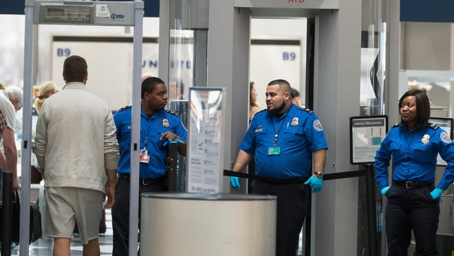 Travelers at Chicago's O'Hare Airport are screened by TSA workers at a security check point on June 2, 2015.