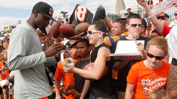 Bengals A.J. Green signs autographs for fans during Training Camp, at the practice field near Paul Brown Stadium last year.