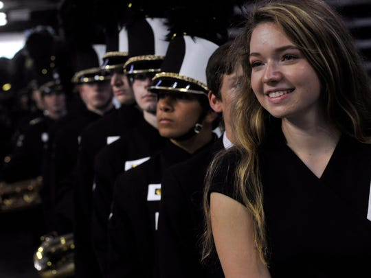 Clyde High School senior Elizabeth Dugan waits with the rest of the Bulldog Band in the tunnel at the Alamodome in San Antonio Tuesday, Nov. 7, 2017, to start its show in the Preliminary Round of the Class 3A UIL State Marching Band Contest. Dugan is one of the drum majors in the band.