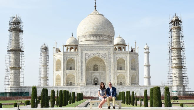 Prince William and Duchess Kate pose at the Taj Mahal in Agra, India on April 16, 2016.