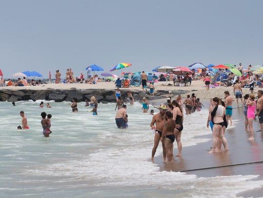 Beachgoers cram the Asbury Park Beach as well as the