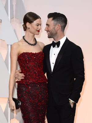 Adam Levine and Behati Prinsloo are too cute for words.