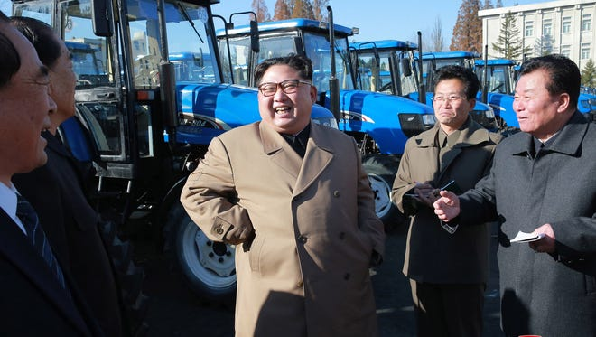 In this undated photo provided Nov. 15, 2017, by the North Korean government, North Korean leader Kim Jong Un visits the Kumsong Tractor Factory in Nampo, North Korea.