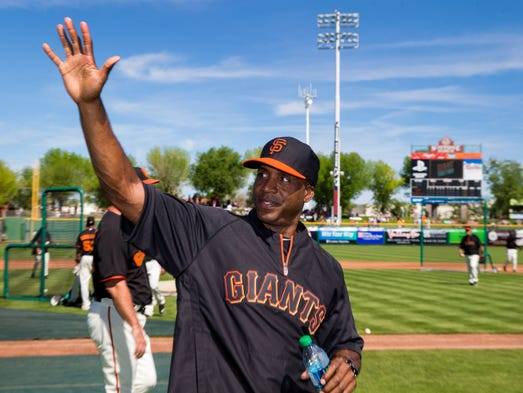 San Francisco Giants former outfielder Barry Bonds waves to the fans prior to the game against the Chicago Cubs at Scottsdale Stadium.