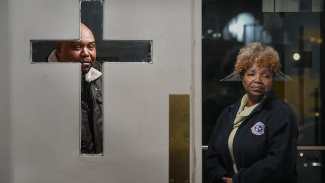 """Bishop Marcus Campbell watches from the lobby with his mother, Belinda Campbell, during a meeting of """"Gentlemen and Not Gangsters,"""" inside his church, Mt. Carmel Missionary Baptist."""