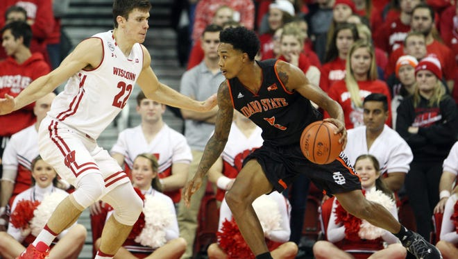 """Former Mansfield Senior star Robert """"Smoke"""" Jones III drives in a game this past season for Idaho State at Wisconsin."""