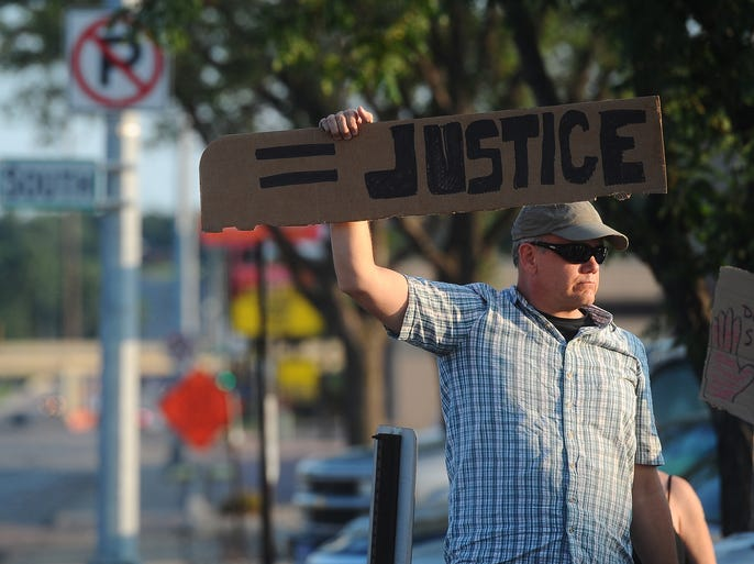 """""""The hands up, don't shoot"""" protest at the corner of 41st Street and Minnesota Ave. in Sioux Falls on Tuesday, Aug. 19, 2014."""
