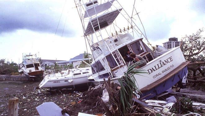 Bill Moore and Ellen Langer on Moore's 41-foot boat Dalliance in Coconut Grove. The boat ended up 100 yards from its mooring after Hurricane Andrew hit in 1992.