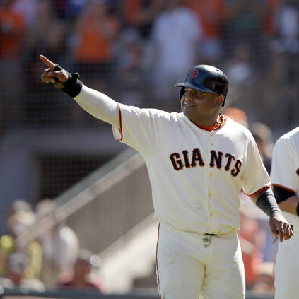SAN FRANCISCO, CA - AUGUST 31: Pablo Sandoval #48 of the San Francisco Giants points back to Andrew Susac #34 after Susac hit a double that scored Pablo Sandoval #48 in the seventh inning against the Milwaukee Brewers at AT&T Park on August 31, 2014 in San Francisco, California.  (Photo by Ezra Shaw/Getty Images)