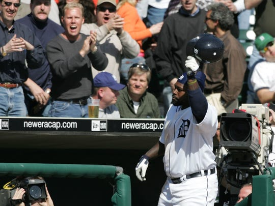 Detroit Tigers' Dmitri Young takes a bow at the top of the dugout steps after his 3rd home run in the Tigers' 11-2 win over the Royals at Comerica Park on April 4, 2005.