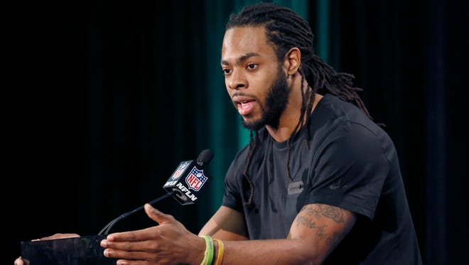 Seattle Seahawks' Richard Sherman answers a question during an interview for NFL Super Bowl XLIX football game, Thursday, Jan. 29, 2015, in Phoenix. The Seahawks play the New England Patriots in Super Bowl XLIX on Sunday, Feb. 1, 2015.