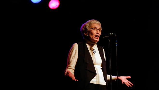 Retired professor Joanne Brown tells her story Thursday, April 28, 2016, during the Des Moines Storytellers Project at Wooly's.