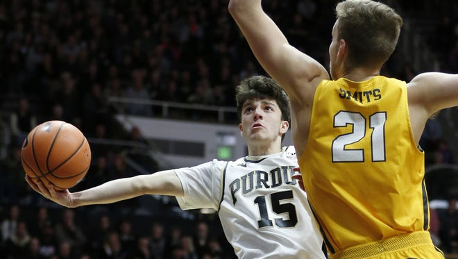 Tommy Luce of Purdue puts up a shot against Derrik Smits of Valparaiso Thursday, December 7, 2017, at Mackey Arena. Purdue defeated Valparaiso 80-50.