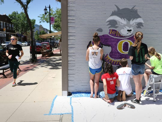 Passersby have been impressed with the artwork created by Nature Hill Intermediate School students on the side of Grill 164 in downtown Oconomowoc.