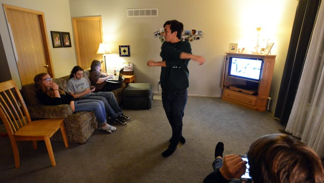Clayton Lunsford swings his arms as he nervously paces through his parent's living room as he waits election results Tuesday, Nov. 7, 2017, in Lancaster. Lunsford a senior at Lancaster High School was running for mayor of Lancaster. He garnered nearly 800 votes.