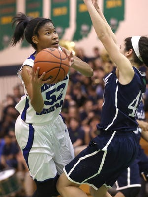Heritage Christian's Tyasha Harris fouls on her way to the basket against Cathedral during the city championship game at Cathedral High School Friday January 16, 2015.