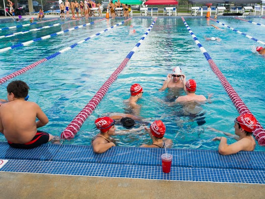 Students swim on Thursday, October 15, 2015 during