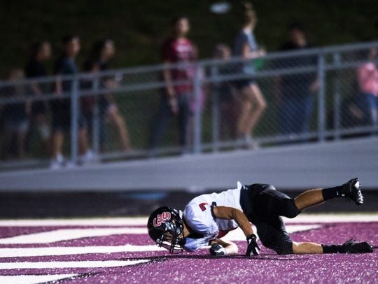 Central's Braden Gaston (7) trips and falls in the