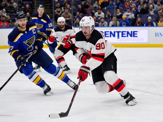 New Jersey Devils left wing Marcus Johansson (90) handles the puck as St. Louis Blues defenseman Alex Pietrangelo (27) defends during the first period at Scottrade Center.