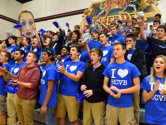 The Harper Creek student section cheers on their volleyball