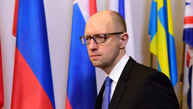Ukrainian Prime Minister Arseniy Yatsenyuk arrives to talk to the press after attending meetings at the European Council, in Brussels on March 18.