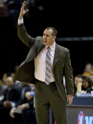 Indiana Pacers head coach Frank Vogel reacts in the first half of an NBA basketball game against the Atlanta Hawks in Indianapolis, Sunday, April 6, 2014. (AP Photo/R Brent Smith)