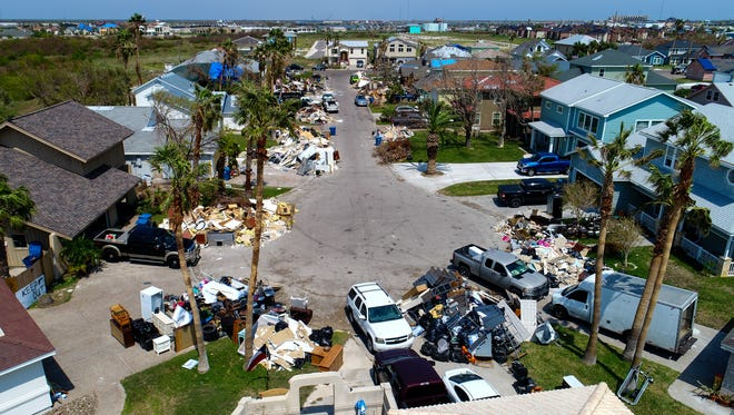 Debris from homes damaged by Hurricanes Harvey line Lydia Ann Channel in Port Aransas on Wednesday, Sept. 14, 2017.