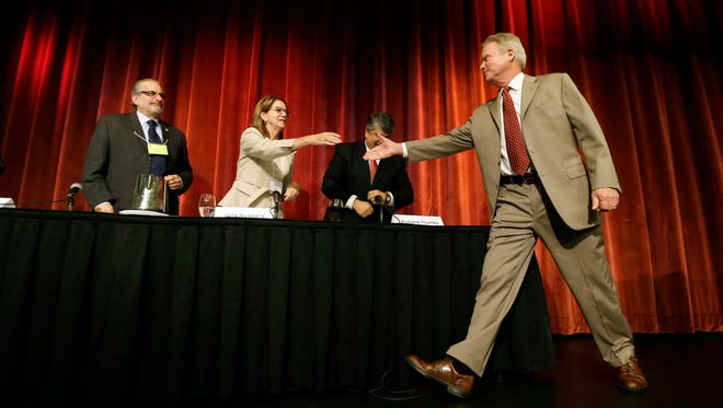 Democratic presidential candidate, former Virginia Sen. Jim Webb, is greeted to the stage before speaking at the Iowa Federation of Labor AFL-CIO Presidential Forum, Thursday, Aug. 6, 2015, in Altoona, Iowa.