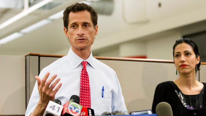 In this July 23, 2013, file photo, Anthony Weiner speaks during a news conference alongside Huma Abedin in New York.