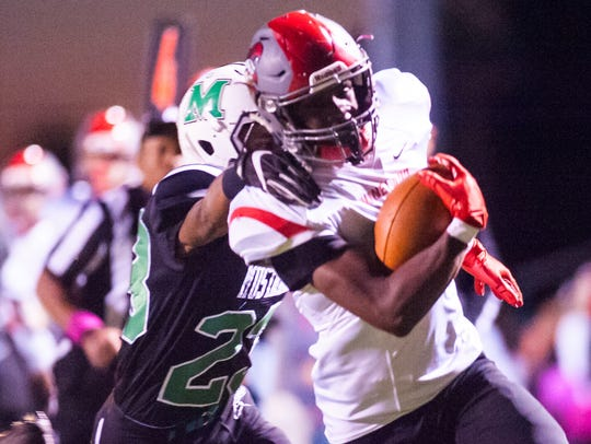 Vineland running back De'Andre Tull-Kennedy (2) works