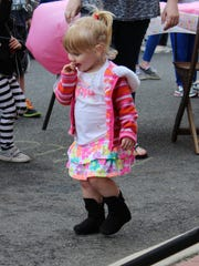 Faith Kaufmann, 1, of Hammonton, dances during the bunny hop.
