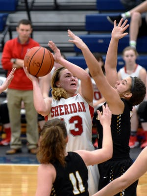 Sheridan's Jayden Geary muscles for two of her team-high 16 points during the third quarter of the Generals' 46-33 loss to Washington Court House Miami Trace on Thursday night in a Division II district semifinal at Southeastern High School.