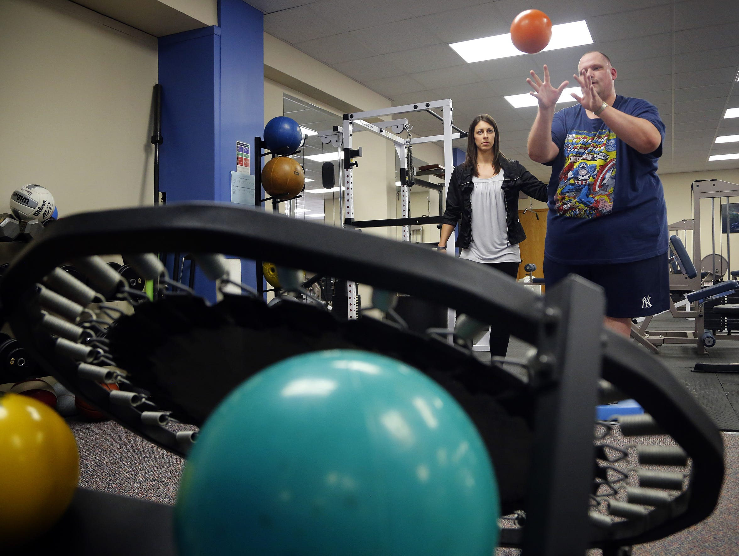 Physical Therapist Stefanie Kirk works with Register