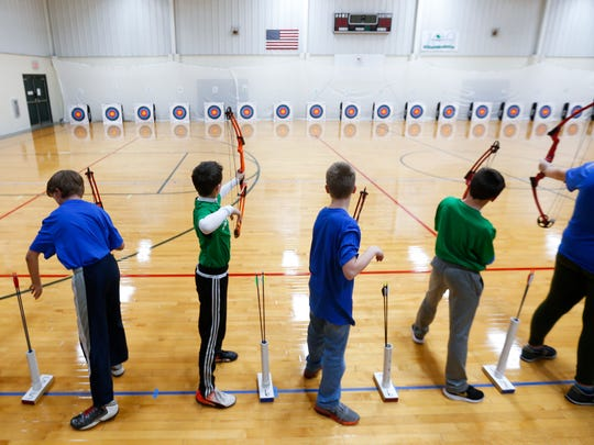 Students from Pipkin Middle School and W.O.L.F. School practice for an archery competition at the O'Reilly-Tefft Gymnasium on Tuesday, Jan. 9, 2018. About 700 Springfield middle school and high school students are competing in the district's first official archery competition.