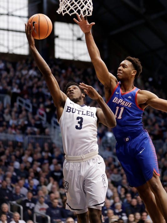 Butler guard Kamar Baldwin (3) shoots in front of DePaul guard Eli Cain (11) in the first half of an NCAA college basketball game in Indianapolis, Saturday, Feb. 3, 2018. (AP Photo/Michael Conroy)