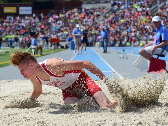 Kuemper Catholic's Miles Rupiper makes a landing in the long jump on Thursday, May 19, 2016, during the Iowa High School State Track Meet at Drake University.