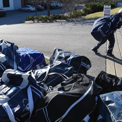 Hockey players pick up their gear outside A-Game Sportsplex