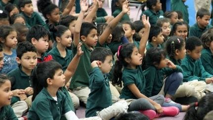 Children in a District of Columbia public school participate in an assembly.