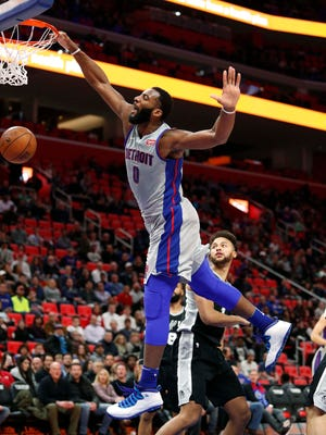 Pistons center Andre Drummond (0) makes a dunk on Spurs forward Kyle Anderson (1) during the first quarter on Saturday, Dec. 30, 2017, at Little Caesars Arena.