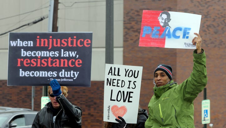 "People hold signs during a gathering called ""We The People Inauguration"" at Veteran's Memorial Park in Nyack Jan. 20, 2017. Approximately 150 people attended that event, which coincided with the inauguration of Donald Trump as President. Speakers at the event called for a ""commitment to peace, justice and compassion,"" as well as call to stand up against the administration of President Donald Trump if he presses ahead with many of the promises made during the campaign on issues such as immigration, Muslim registry, and women's rights."