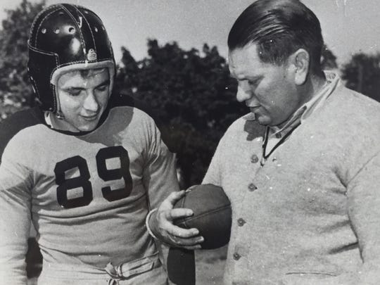 Long-time Middletown football coach Arnie Truex (right) gives advice to Middletown football great Ted Lauer in 1947.