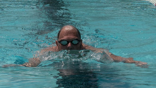 Ed Jekel takes a lap at the Twin Rivers YMCA.