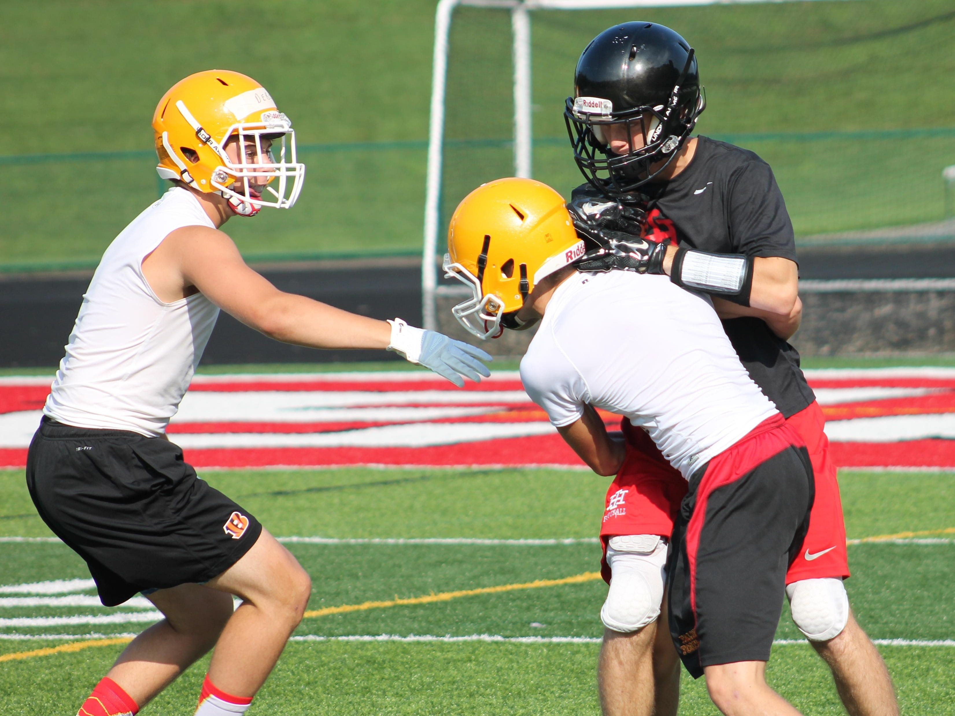 Indian Hill junior Dawson Aichholz comes down with a reception during a 7-on-7 drill with Fenwick.
