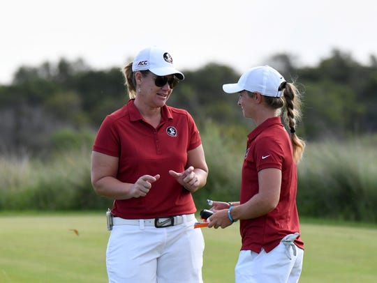 Florida State head coach Amy Bond (left) will donate
