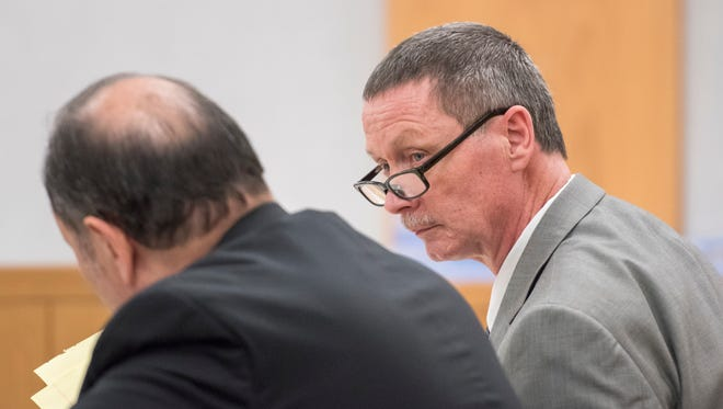 Charlie Hamrick, a former Tate High School supplemental football coach, shows a note to his attorney during his trial in Pensacola on Tuesday, Nov. 28, 2017.