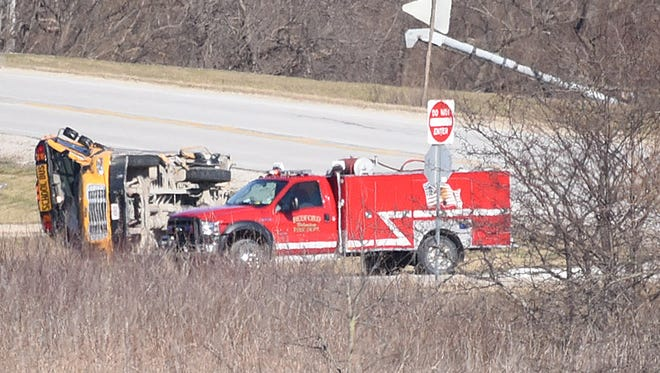 Five students and two adults have been transported to local hospitals following an accident that left a bus turned on its side in Bedford on Wedhesday morning.