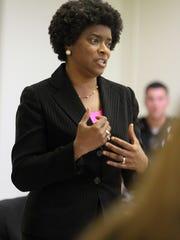 Velda Jones-Potter speaks to members of the Westside Neighborhood Coalition during a meeting Wednesday, Sept. 18, 2013.
