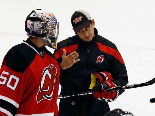 New Jersey Devils goaltending coach Chris Terreri talks with goalie Maxime Clermont, of Canada, during NHL hockey training camp, Saturday, Sept. 17, 2011, in Newark, N.J. (AP Photo/Mel Evans)
