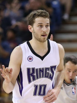 Sacramento Kings guard Nik Stauskas (10) gestures after a three point basket against the Charlotte Hornets during the first quarter at Sleep Train Arena.